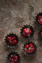 Cherries in a muffin tin Royalty Free Stock Photo
