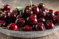 Cherries on a plate of glass Stock Image