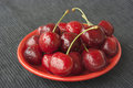 Cherries on a red plate Royalty Free Stock Images