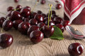 Cherries on a wooden table Royalty Free Stock Photos