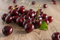 Cherries on a wooden table Royalty Free Stock Images