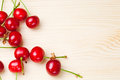 Cherries on wooden table ripe Stock Images