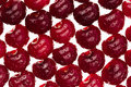 Cherry background. Ripe fresh  glossy rich cherries on white background.  Macro.  Texture. Pattern. Fruit background. Royalty Free Stock Photo