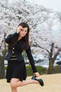 Cherry blossom with woman holding shoes Stock Photography