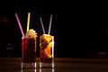 Cherry bomb and cuba libre cocktails in a tall glasses Royalty Free Stock Photo