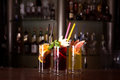 Cherry bomb, screwdriver and cuba libre cocktails in a tall glas Royalty Free Stock Photo