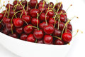 Cherry in the bowl white background Stock Photos