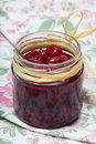 Cherry confiture homemade served in a jar Stock Photo