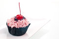 Cherry cupcake close up Royalty Free Stock Images