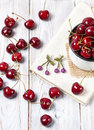 Cherry earrings and handmade on the book and wooden table Royalty Free Stock Photos