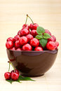 Cherry fruits in brown bowl Stock Images