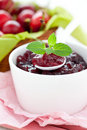 Cherry jam with spoon Stock Photography