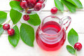Cherry juice fresh and fresh fruits with leaves Royalty Free Stock Photography