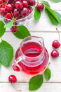 Cherry juice fresh and fresh fruits with leaves Stock Photo
