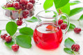 Cherry juice fresh and fresh fruits with leaves Royalty Free Stock Image
