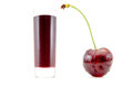 Cherry juice in a glass with a high near cherry isolated on white Royalty Free Stock Photo