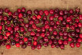 Cherry lies on sackcloth can be used as background Royalty Free Stock Photo