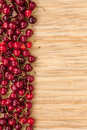 Cherry lying on bamboo mat can be used as background Royalty Free Stock Image