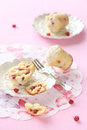 Cherry muffins broken almond muffin on a plate and pink background Royalty Free Stock Image