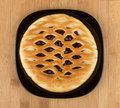 Cherry pie in black glass plate Royalty Free Stock Photo