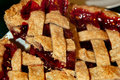 Cherry pie with lattice crust closeup of a slice of backed homemade golden Royalty Free Stock Image