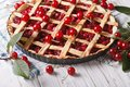 Cherry pie and ripe berries on the table. Horizontal Royalty Free Stock Photo