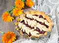 Cherry pie on the wooden table background Stock Photos