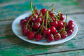 Cherry on a plate on  table Royalty Free Stock Photo