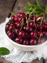 Cherry ripe in rustic bowl selective focus Stock Photo