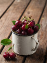 Cherry ripe in vintage cup selective focus Stock Photo
