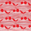 Cherry silhouette seamless pattern for fabric design. Red cherries wallpaper on stripes background Royalty Free Stock Photo