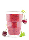 Cherry smoothie big glass of fresh on white Stock Image