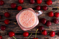 Cherry smoothie in jar glass on wooden table. healthy food concept for breakfast or snack. Royalty Free Stock Photo