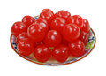 Cherry sours small dish a group of shiny red flavored candy balls in Royalty Free Stock Image
