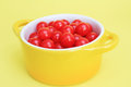 Cherry sours on yellow bright red candy in bowl background Stock Photos