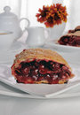 Cherry strudel piece of on the coffee table Royalty Free Stock Photo