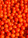 Cherry tomato background piles of tomatoes colorful abstract Stock Image