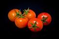 Cherry tomato on black Royalty Free Stock Photo