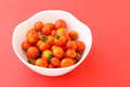Cherry tomato in the bowl with pink background Stock Image