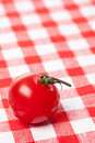 Cherry tomato on checkered tablecloth Stock Images