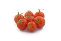 Cherry tomato in the foreground tomatoes on white background Stock Image