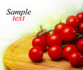Cherry tomatoes on around wood board Royalty Free Stock Photography
