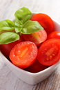 Cherry tomatoes with basil in glass bowl, healthy food and nutrition Royalty Free Stock Photo