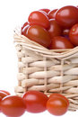 Cherry tomatoes in basket Stock Photos