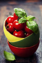 Cherry tomatoes in a bowl with basil over wood Royalty Free Stock Photo