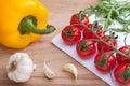Cherry tomatoes bunch, arugula, garlic, paprika Stock Image