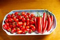Cherry tomatoes and chili peppers Royalty Free Stock Photo