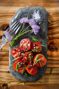 Cherry tomatoes on flat stone Royalty Free Stock Photo