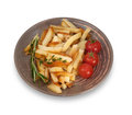 Cherry tomatoes fried potatoes and branch of rosemary isolated in brown plate on white background Royalty Free Stock Images