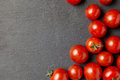 Cherry tomatoes over stone table. Royalty Free Stock Photo